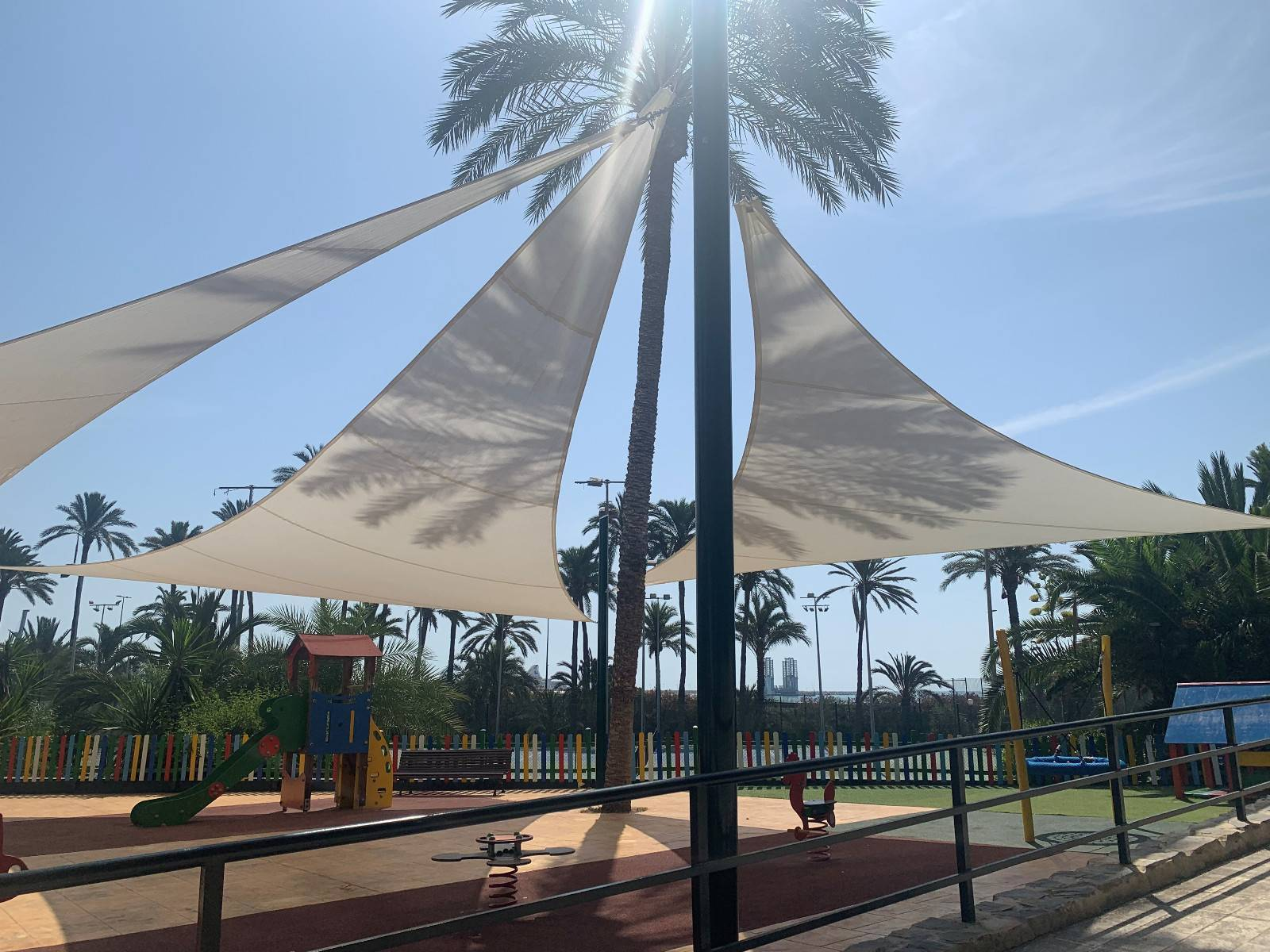 Tensioned shade sails or awning sail in a playground in the Urbanova Urbanization (Alicante).